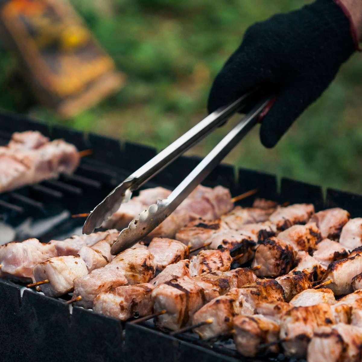 marinated-shashlik-meat-grilling-on-metal-skewer-c-PWDYUJE